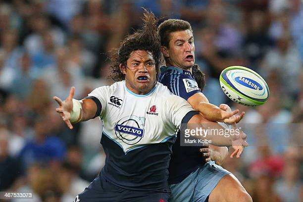 Tatafu Polota Nau of the Waratahs and Chris Noakes of the Blues compete for the ball during the Super Rugby trial match between the Waratahs and the...