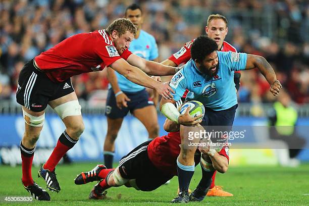 Tatafu Polota Nau of the Waratahs is tackled during the Super Rugby Grand Final match between the Waratahs and the Crusaders at ANZ Stadium on August...
