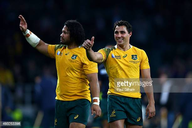 Tatafu PolotaNau and Nick Phipps of Australia celebrate after the 2015 Rugby World Cup Quarter Final match between Australia and Scotland at...