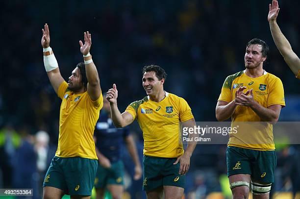 Tatafu PolotaNau Nick Phipps and Kane Douglas of Australia celebrate after the 2015 Rugby World Cup Quarter Final match between Australia and...
