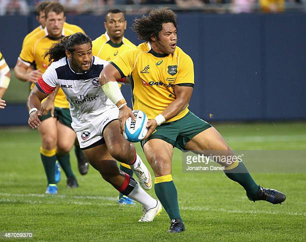Tatafu PolotaNau of the Australia Wallabies passes against the United States Eagles during a match at Soldier Field on September 5 2015 in Chicago...