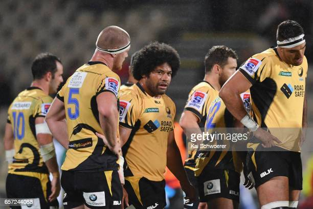Tatafu PolotaNau of the Force and his team mates look dejected after conceding a try during the round five Super Rugby match between the Crusaders...
