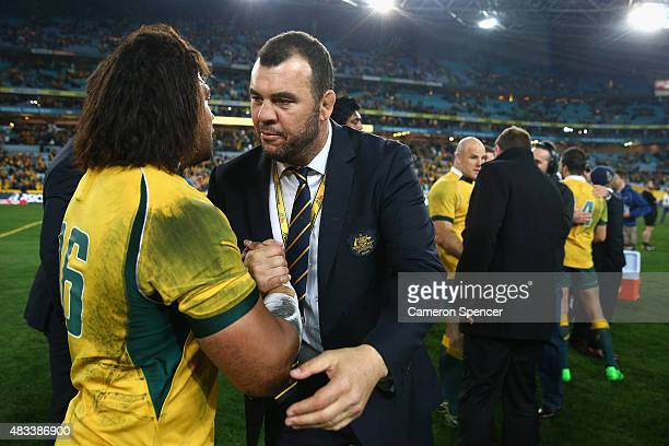 Tatafu PolotaNau of the Wallabies is congratulated by Wallabies coach Michael Cheika after winning the Rugby Championship match between the Australia...