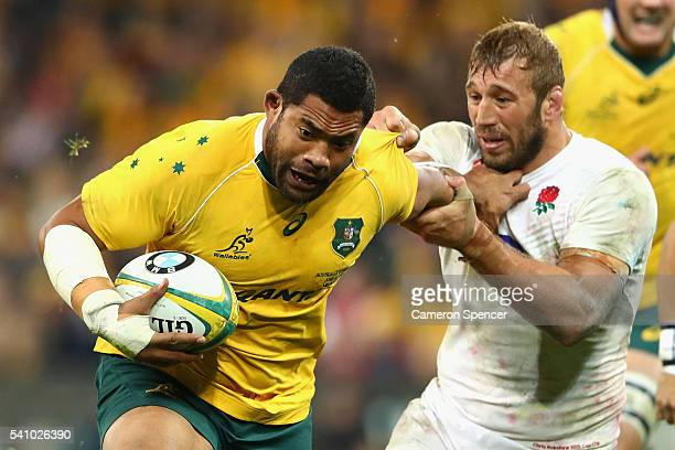 Tatafu PolotaNau of the Wallabies is tackled during the International Test match between the Australian Wallabies and England at AAMI Park on June 18...