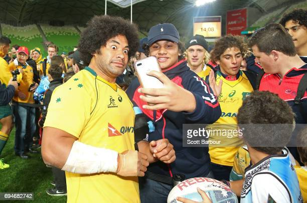 Tatafu PolotaNau of the Wallabies signs autographs for supporters in the crowd after the International Test match between the Australian Wallabies...