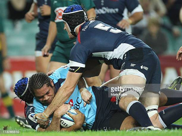 Tatafu PolotaNau of the Waratahs dives over to score a try during the round 11 Super Rugby match between the Waratahs and the Rebels at the Sydney...