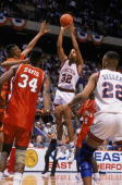 Tate George of the UConn Huskies puts up a shot during the 1990 'sweet sixteen' NCAA Tournament basketball game against Clemson at the Meadowlands on...