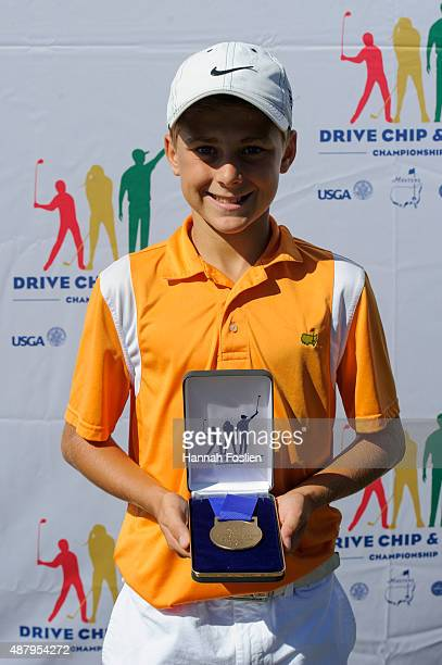 Tate Herrenbruck poses for a photo after winning first place overall at a Regional Finals for 1213 year old boys at the Drive Chip and Putt...