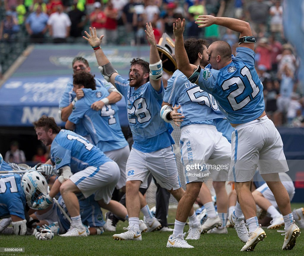 Tate Jozokos #28, Kevin Walker #50, and Michael Tagliaferri #21 of the North Carolina Tar Heels react after defeating the Maryland Terrapins in overtime in the NCAA Division I Men's Lacrosse Championship at Lincoln Financial Field on May 30, 2016 in Philadelphia, Pennsylvania. The Tar Heels defeated the Terrapins 14-13.