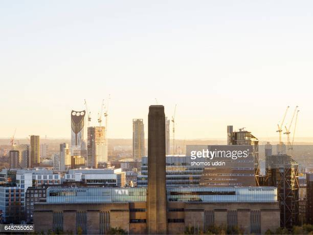 Tate Modern and the changing city skyline at sunset