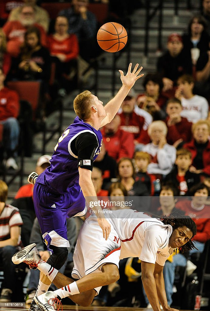 Tate Stensgaard #32 of the Western Illinois Leathernecks reaches for a ball over David Rivers #2 of the Nebraska Cornhuskers during their game at Pinnacle Bank Arena on November 12, 2013 in Lincoln, Nebraska.