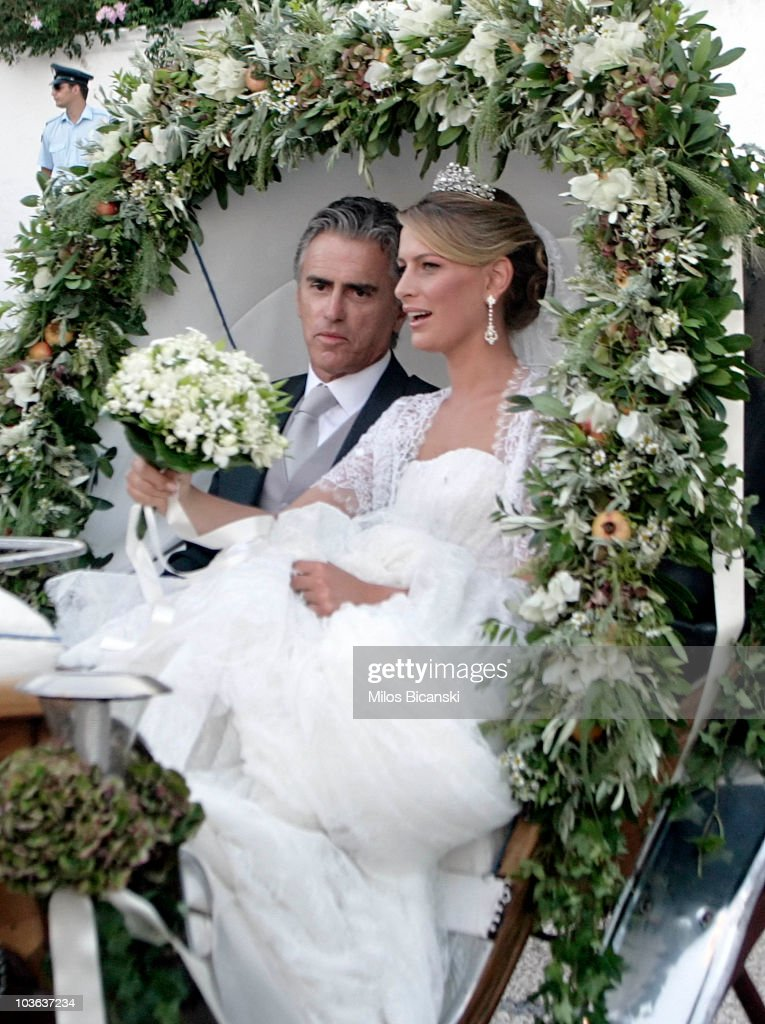 Tatiana Blatnik (R) and her father Atilio Brillembourg arrive at the Cathedral of Ayios Nikolaos (St. Nicholas) for her wedding to Prince Nikolaos of Greece on August 25, 2010 in Spetses, Greece. Representatives from Europe's royal families will join the many guests who have travelled to the island to attend the wedding of Prince Nikolaos of Greece, the second son of King Constantine of Greece and Queen Anne-Marie of Greece and Tatiana Blatnik an events planner for Diane Von Furstenburg in London.
