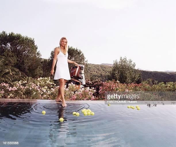 Tatiana Golovin At The Art Dealer Enrico Navarra In Muy In The Var Tennis player Tatiana GOLOVIN posing in the pool in the park of the secondary...
