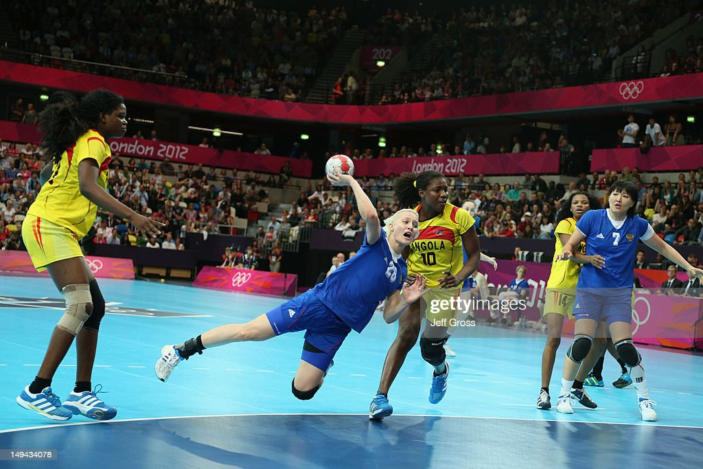 <a gi-track='captionPersonalityLinkClicked' href=/galleries/search?phrase=Tatiana+Khmyrova&family=editorial&specificpeople=5639365 ng-click='$event.stopPropagation()'>Tatiana Khmyrova</a> of Russia scores a goal in the Women's Handball preliminaries Group A - Match 1 between Russia and Angola on Day 1 of the London 2012 Olympic Games at the Copper Box on July 28, 2012 in London, England.