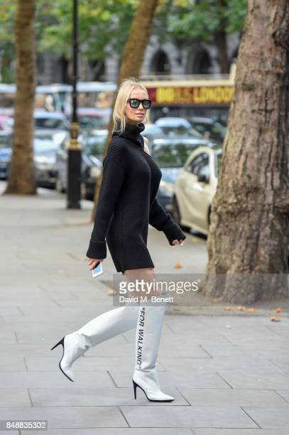 Tatiana Korsakova seen wearing a Monse dress boots by OffWhite Repossi jewelry and REVE sunglasses on Day 3 of London Fashion Week September 2017 on...