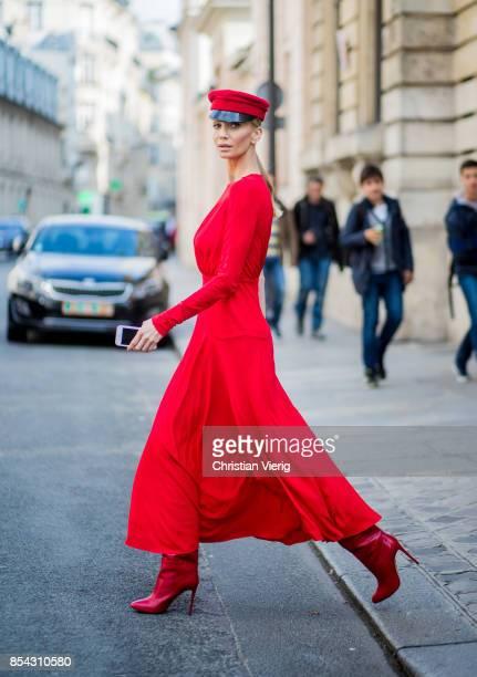 Tatiana Korsakova wearing a red dress Antonio Berardi boots Aquazzura hat Ruslan Baginskiy at Dior show during Paris Fashion Week at Musee Rodin on...