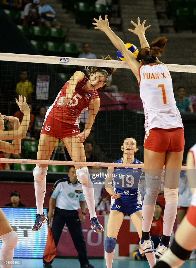 <a gi-track='captionPersonalityLinkClicked' href=/galleries/search?phrase=Tatiana+Kosheleva&family=editorial&specificpeople=4523874 ng-click='$event.stopPropagation()'>Tatiana Kosheleva</a> of Russia spikes the ball during the FIVB World Grand Prix Final group one match between Russia and China on August 24, 2014 in Tokyo, Japan.