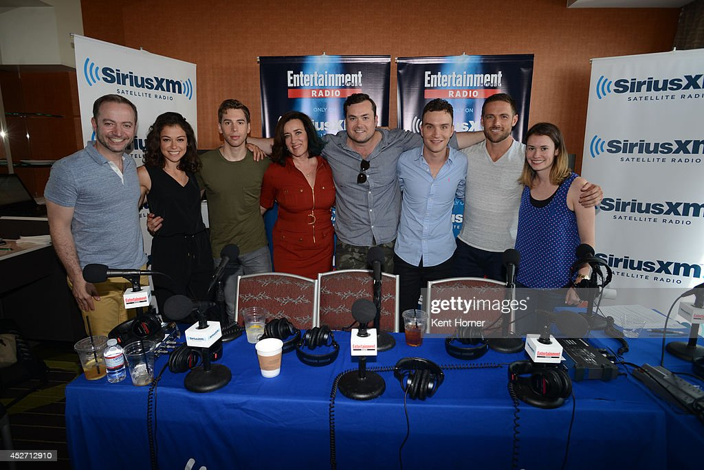 Tatiana Maslany, Jordan Gavaris, Maria Doyle, Ari Millen, Kristian Braun and Dylan Bruce pose with radio hosts Mario Correa and Julia Cunningham after being interviewed on SiriusXM's Entertainment Weekly Radio channel from Comic-Con 2014 at The Hard Rock Hotel on July 25, 2014 in San Diego, California.