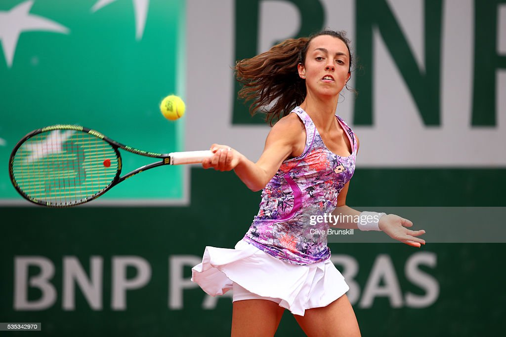 Tatiana Pieri of Italy hits a forehand during the Girls Singles first round match against Usue Maitane Arconada of the United States on day eight of the 2016 French Open at Roland Garros on May 29, 2016 in Paris, France.