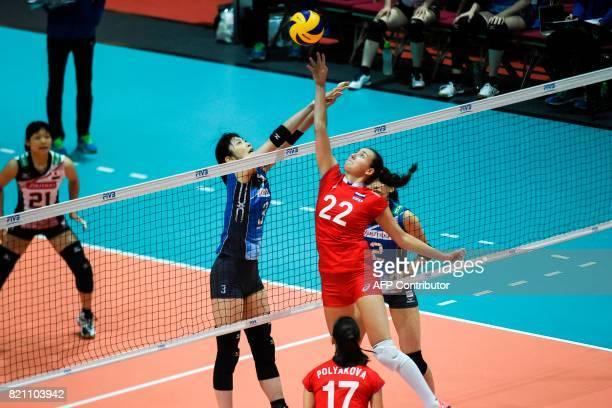 Tatiana Romanova of Russia competes for the ball against Nana Iwasaka of Japan during a match at the Women's Volleyball World Grand Prix in Hong Kong...