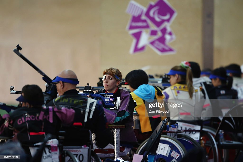 Tatiana Ryabchenko of Russia (C) competes in the mixed R6-50m Rifle Prone- SH1 qualification round on day 6 of the London 2012 Paralympic Games at The Royal Artillery Barracks on September 4, 2012 in London, England.