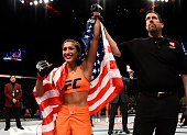 Tatiana Suarez celebrates after her submission victory over Amanda Cooper in their women's strawweight bout during The Ultimate Fighter Finale event...