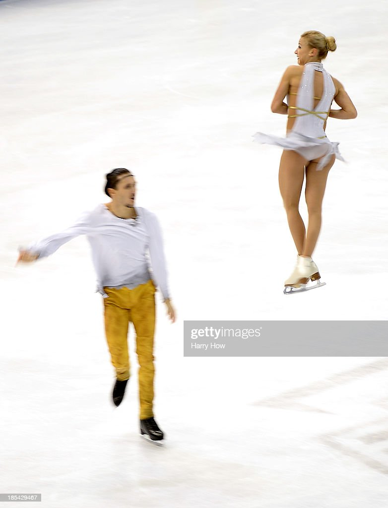 <a gi-track='captionPersonalityLinkClicked' href=/galleries/search?phrase=Tatiana+Volosozhar&family=editorial&specificpeople=798077 ng-click='$event.stopPropagation()'>Tatiana Volosozhar</a> and <a gi-track='captionPersonalityLinkClicked' href=/galleries/search?phrase=Maxim+Trankov&family=editorial&specificpeople=798054 ng-click='$event.stopPropagation()'>Maxim Trankov</a> compete to a gold medal during the pairs free at Skate America 2013 at the Joe Louis Arena on October 20, 2013 in Detroit, Michigan.