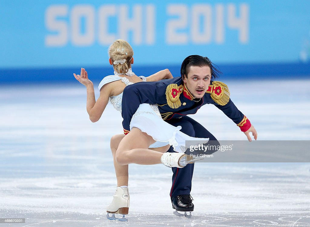 <a gi-track='captionPersonalityLinkClicked' href=/galleries/search?phrase=Tatiana+Volosozhar&family=editorial&specificpeople=798077 ng-click='$event.stopPropagation()'>Tatiana Volosozhar</a> and <a gi-track='captionPersonalityLinkClicked' href=/galleries/search?phrase=Maxim+Trankov&family=editorial&specificpeople=798054 ng-click='$event.stopPropagation()'>Maxim Trankov</a> of Russia compete during the Figure Skating Pairs Short Program on day four of the Sochi 2014 Winter Olympics at Iceberg Skating Palace on February 11, 2014 in Sochi, Russia.