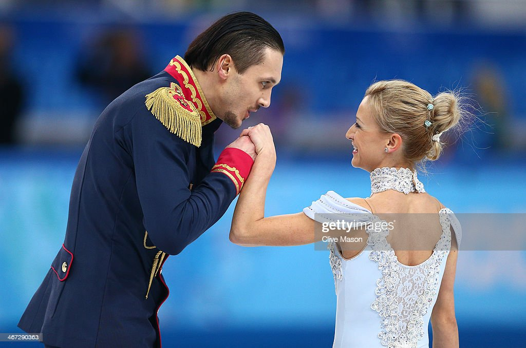 <a gi-track='captionPersonalityLinkClicked' href=/galleries/search?phrase=Tatiana+Volosozhar&family=editorial&specificpeople=798077 ng-click='$event.stopPropagation()'>Tatiana Volosozhar</a> and <a gi-track='captionPersonalityLinkClicked' href=/galleries/search?phrase=Maxim+Trankov&family=editorial&specificpeople=798054 ng-click='$event.stopPropagation()'>Maxim Trankov</a> of Russia compete in the Figure Skating Pairs Short Program during the Sochi 2014 Winter Olympics at Iceberg Skating Palace on February 6, 2014 in Sochi, Russia.