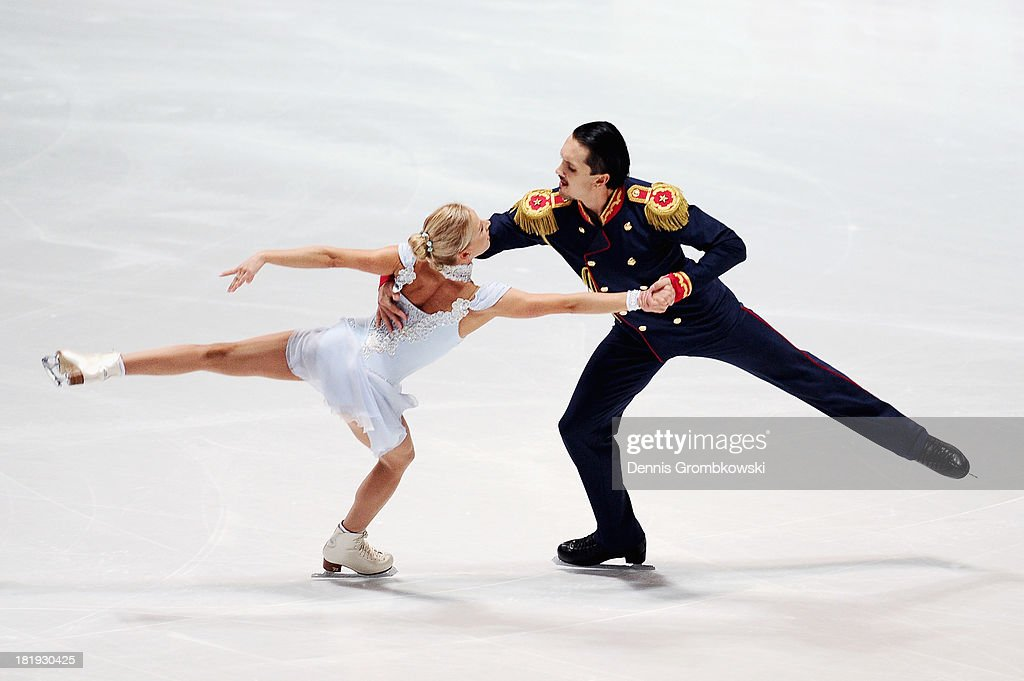 <a gi-track='captionPersonalityLinkClicked' href=/galleries/search?phrase=Tatiana+Volosozhar&family=editorial&specificpeople=798077 ng-click='$event.stopPropagation()'>Tatiana Volosozhar</a> and <a gi-track='captionPersonalityLinkClicked' href=/galleries/search?phrase=Maxim+Trankov&family=editorial&specificpeople=798054 ng-click='$event.stopPropagation()'>Maxim Trankov</a> of Russia compete in the Pairs Short Program during day one of the ISU Nebelhorn Trophy at Eissportzentrum Oberstdorf on September 26, 2013 in Oberstdorf, Germany.