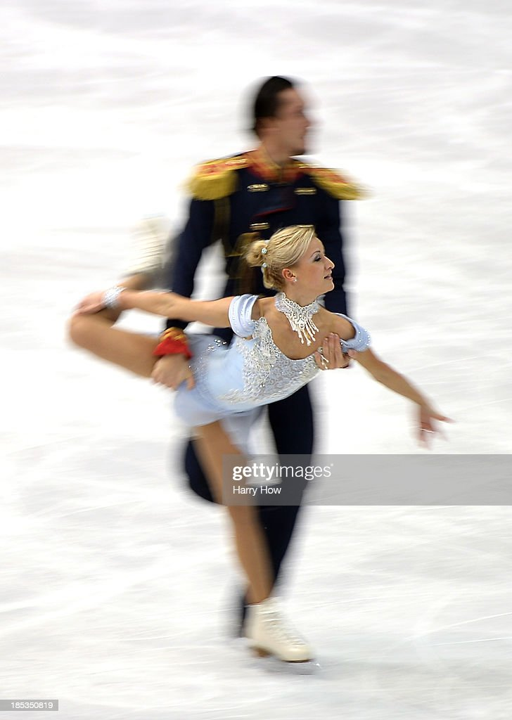 Tatiana Volosozhar and Maxim Trankov of Russia compete in the pairs short program at Skate America 2013 at Joe Louis Arena on October 19, 2013 in Detroit, Michigan.
