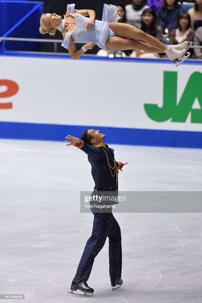 Tatiana Volosozhar and Maxim Trankov of Russia compete in the pairs short program during day one of ISU Grand Prix of Figure Skating 2013/2014 NHK Trophy at Yoyogi National Gymnasium on November 8, 2013 in Tokyo, Japan.