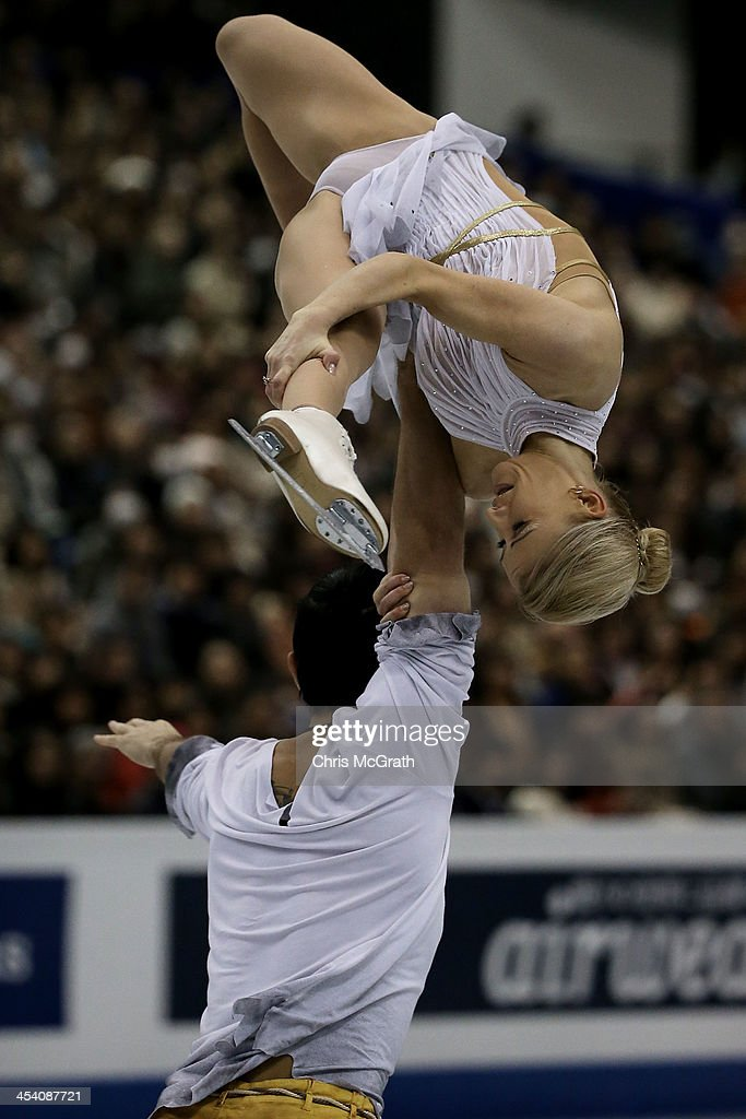 <a gi-track='captionPersonalityLinkClicked' href=/galleries/search?phrase=Tatiana+Volosozhar&family=editorial&specificpeople=798077 ng-click='$event.stopPropagation()'>Tatiana Volosozhar</a> and <a gi-track='captionPersonalityLinkClicked' href=/galleries/search?phrase=Maxim+Trankov&family=editorial&specificpeople=798054 ng-click='$event.stopPropagation()'>Maxim Trankov</a> of Russia compete in the Pairs Free Skating Final during day three of the ISU Grand Prix of Figure Skating Final 2013/2014 at Marine Messe Fukuoka on December 7, 2013 in Fukuoka, Japan.