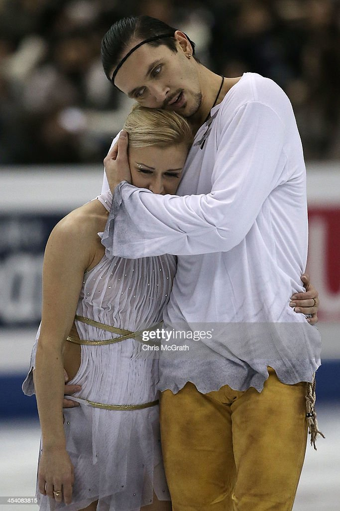 <a gi-track='captionPersonalityLinkClicked' href=/galleries/search?phrase=Tatiana+Volosozhar&family=editorial&specificpeople=798077 ng-click='$event.stopPropagation()'>Tatiana Volosozhar</a> and <a gi-track='captionPersonalityLinkClicked' href=/galleries/search?phrase=Maxim+Trankov&family=editorial&specificpeople=798054 ng-click='$event.stopPropagation()'>Maxim Trankov</a> of Russia embrace after their routine in the Pairs Free Skating Final during day three of the ISU Grand Prix of Figure Skating Final 2013/2014 at Marine Messe Fukuoka on December 7, 2013 in Fukuoka, Japan.