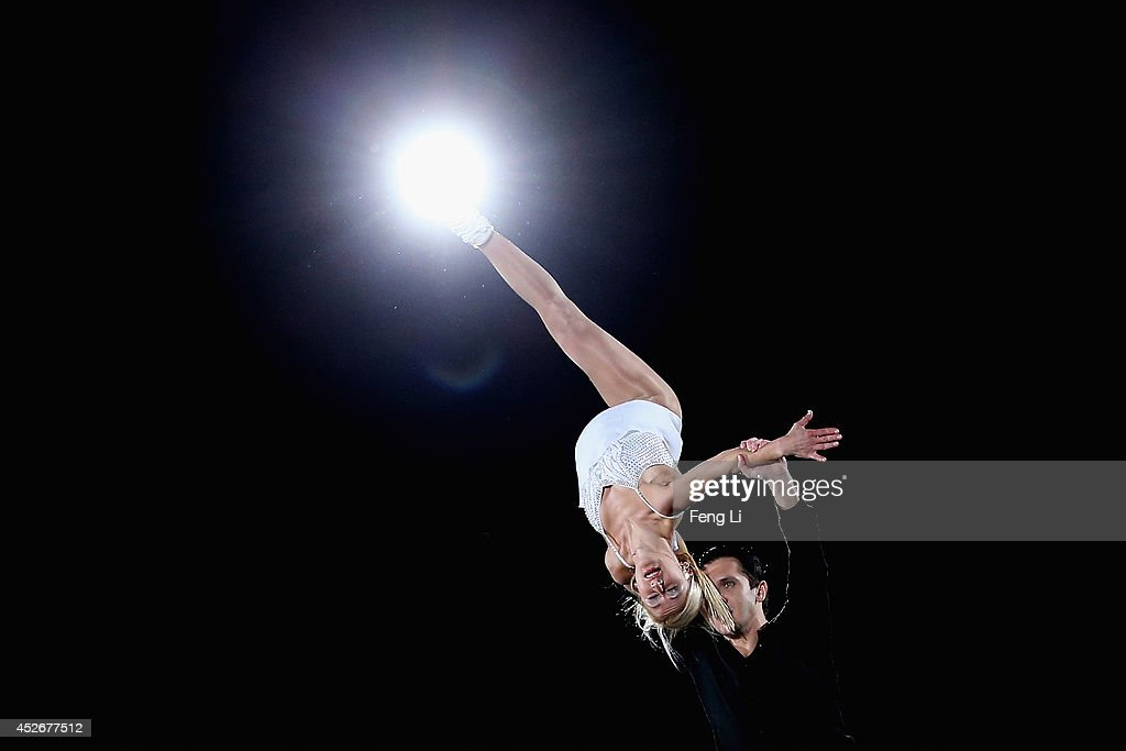 Tatiana Volosozhar and Maxim Trankov of Russia perform during Artistry On Ice 2014 on July 25, 2014 in Beijing, China.