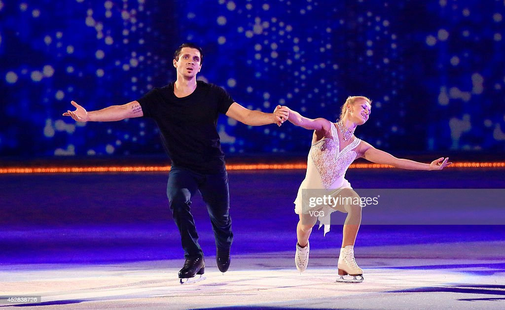 <a gi-track='captionPersonalityLinkClicked' href=/galleries/search?phrase=Tatiana+Volosozhar&family=editorial&specificpeople=798077 ng-click='$event.stopPropagation()'>Tatiana Volosozhar</a> and <a gi-track='captionPersonalityLinkClicked' href=/galleries/search?phrase=Maxim+Trankov&family=editorial&specificpeople=798054 ng-click='$event.stopPropagation()'>Maxim Trankov</a> of Russia perform during Artistry On Ice 2014 at Mercedes-Benz Arena on July 27, 2014 in Shanghai, China.