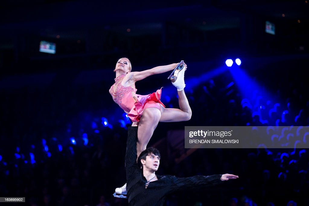Tatiana Volosozhar and Maxim Trankov of Russia perform during the exhibition program at the 2013 World Figure Skating Championships on March 17, 2013 in London, Ontario. Gold, silver and bronze medalists of the championships as well as invited skaters performed in the post-competition exhibition. AFP PHOTO/Brendan SMIALOWSKI