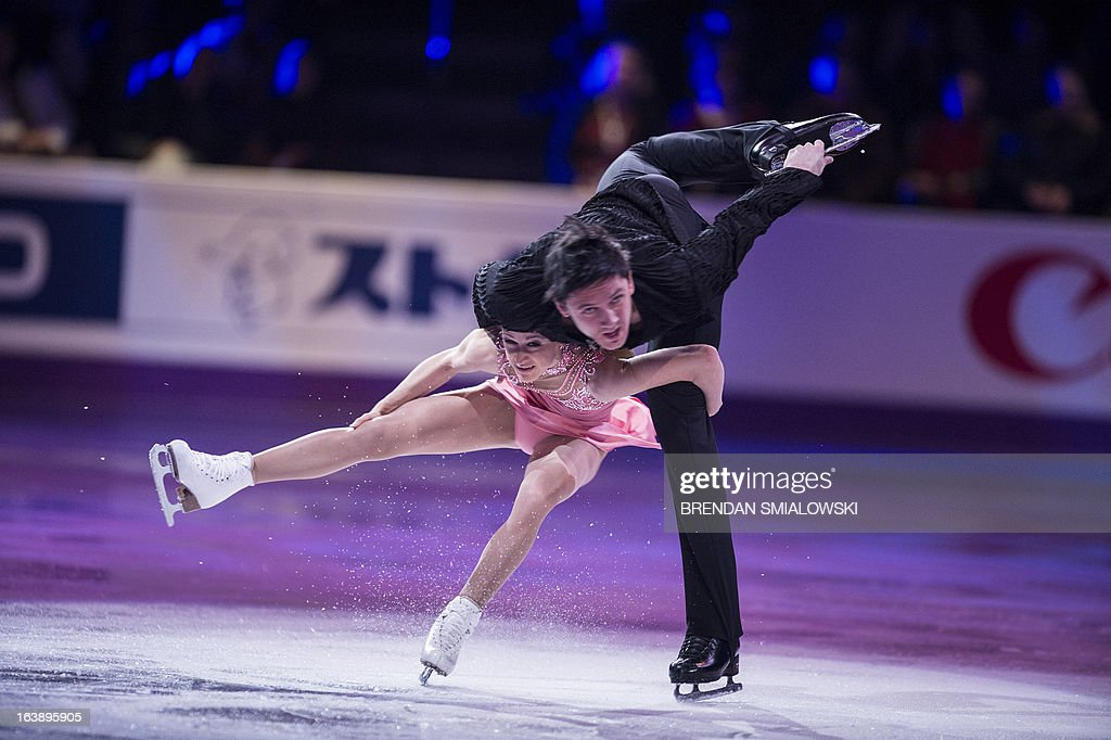 Tatiana Volosozhar and Maxim Trankov of Russia perform during the exhibition program at the 2013 World Figure Skating Championships on March 17, 2013 in London, Ontario. AFP PHOTO/Brendan SMIALOWSKI