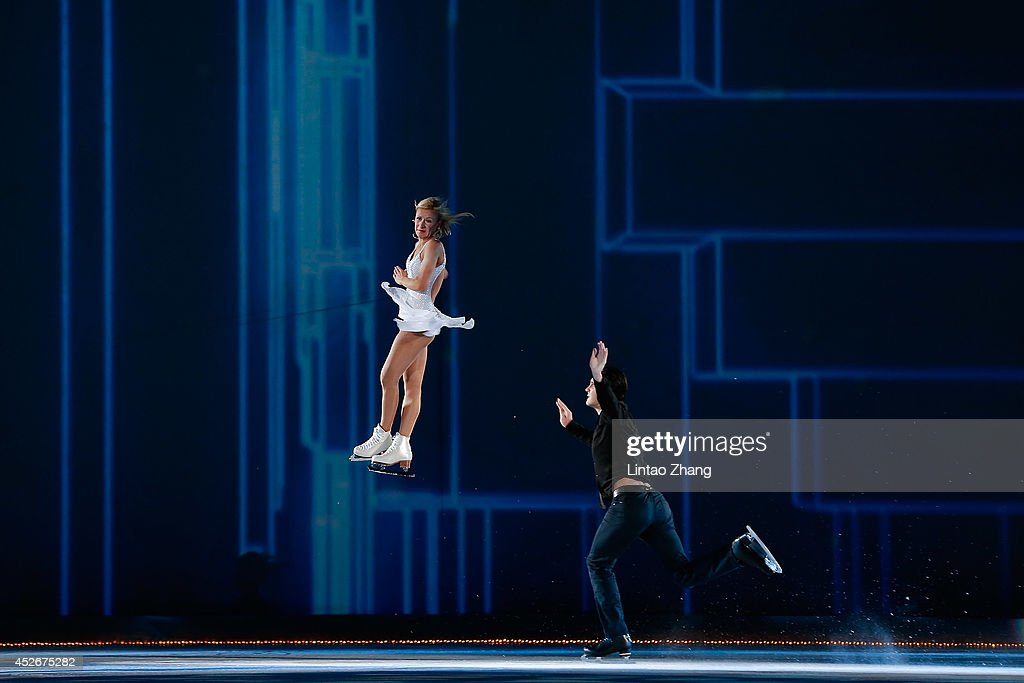 Tatiana Volosozhar and Maxim Trankov of Russia performs during the 2014 Artistry On Ice Beijing at Beijing MasterCard Center on July 25, 2014 in Beijing, China.