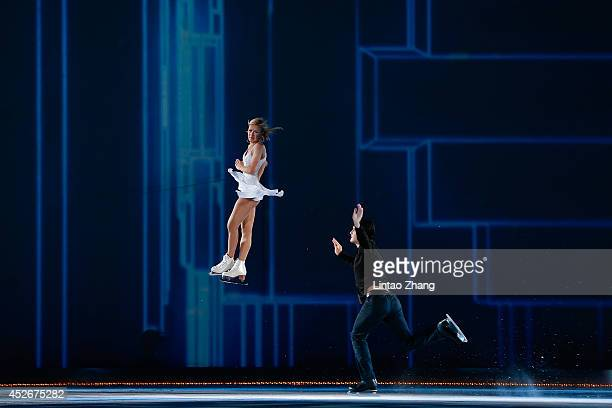 Tatiana Volosozhar and Maxim Trankov of Russia performs during the 2014 Artistry On Ice Beijing at Beijing MasterCard Center on July 25 2014 in...