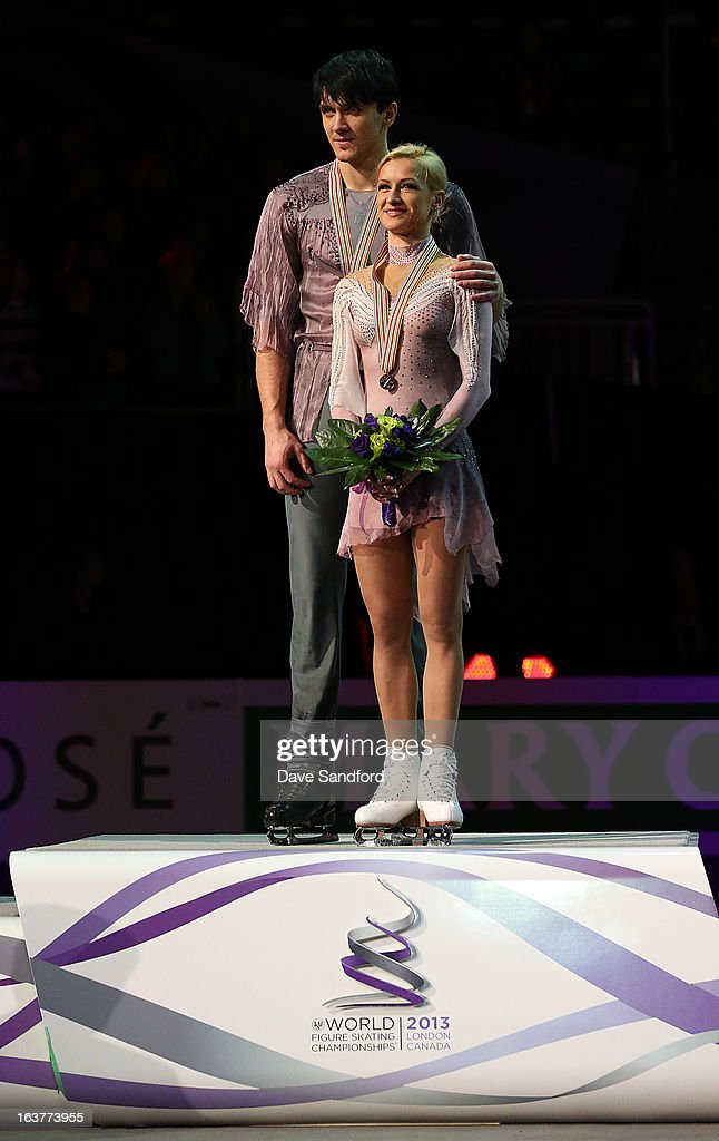Tatiana Volosozhar and Maxim Trankov of Russia receive their gold medals after skating in the Pairs Free Skating Program during the 2013 ISU World Figure Skating Championships at Budweiser Gardens on March 15, 2013 in London, Ontario, Canada.