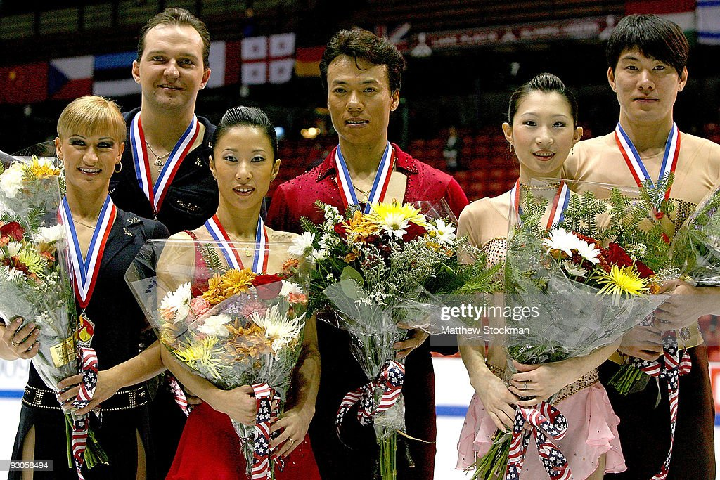 Tatiana Volosozhar and Stanislav Morozov of Russia, <a gi-track='captionPersonalityLinkClicked' href=/galleries/search?phrase=Hongbo+Zhao&family=editorial&specificpeople=178290 ng-click='$event.stopPropagation()'>Hongbo Zhao</a>, <a gi-track='captionPersonalityLinkClicked' href=/galleries/search?phrase=Xue+Shen&family=editorial&specificpeople=178359 ng-click='$event.stopPropagation()'>Xue Shen</a>, Dan Zhang and Hao Zhang of China pose for photographers after the Pairs competition during the Cancer.Net Skate America at Herb Brooks Arena on November 14, 2009 in Lake Placid, New York. Volosozhar and Morozov finished second. Zhao and Shen won the event. Zhang and Zhang placed third.