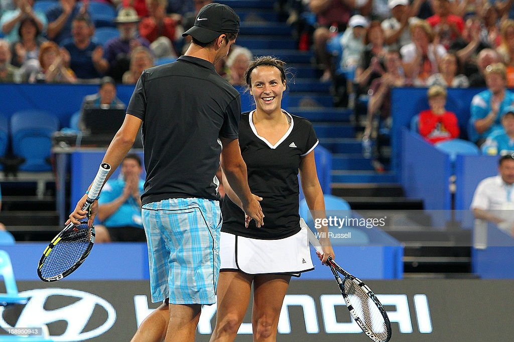 <a gi-track='captionPersonalityLinkClicked' href=/galleries/search?phrase=Tatjana+Malek&family=editorial&specificpeople=3945871 ng-click='$event.stopPropagation()'>Tatjana Malek</a> and Thanasi Kokkinakis of Germany celebrate winning a point in their mixed doubles match against Ana Ivanovic and Novak Djokovic of Serbia during day seven of the Hopman Cup at Perth Arena on January 4, 2013 in Perth, Australia.