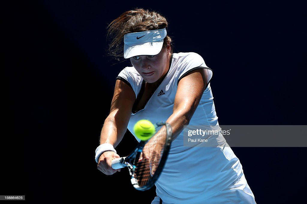 <a gi-track='captionPersonalityLinkClicked' href=/galleries/search?phrase=Tatjana+Malek&family=editorial&specificpeople=3945871 ng-click='$event.stopPropagation()'>Tatjana Malek</a> of Germany plays a backhand to Francesca Schiavone of Italy in her singles match during day five of the Hopman Cup at Perth Arena on January 2, 2013 in Perth, Australia.
