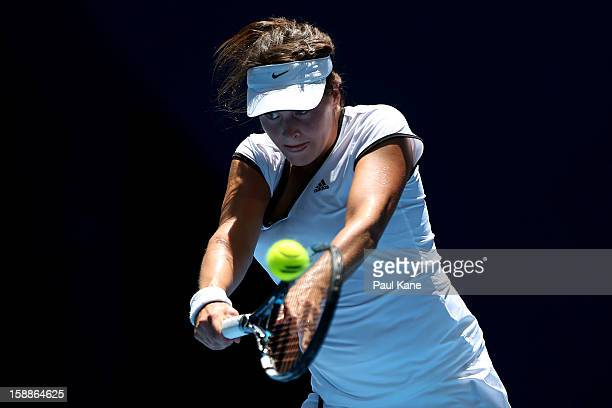 Tatjana Malek of Germany plays a backhand to Francesca Schiavone of Italy in her singles match during day five of the Hopman Cup at Perth Arena on...