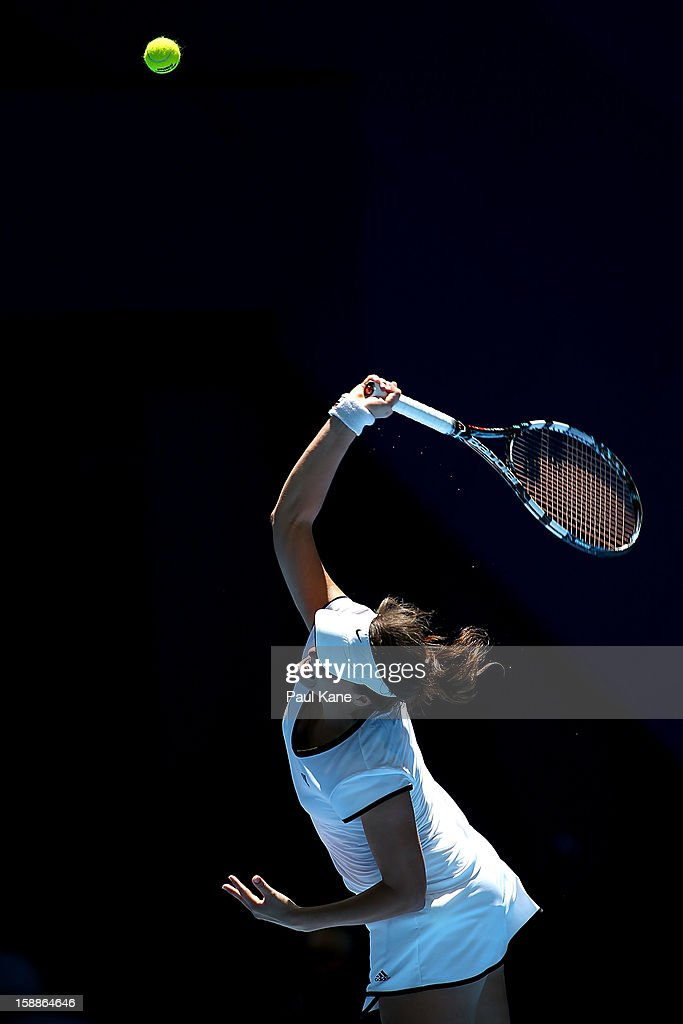 Tatjana Malek of Germany serves to Francesca Schiavone of Italy in her singles match during day five of the Hopman Cup at Perth Arena on January 2, 2013 in Perth, Australia.