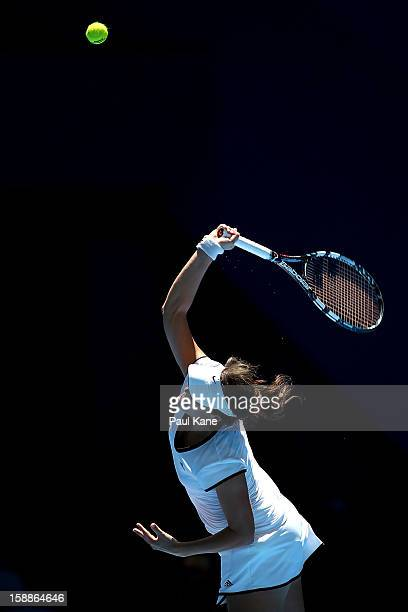 Tatjana Malek of Germany serves to Francesca Schiavone of Italy in her singles match during day five of the Hopman Cup at Perth Arena on January 2...