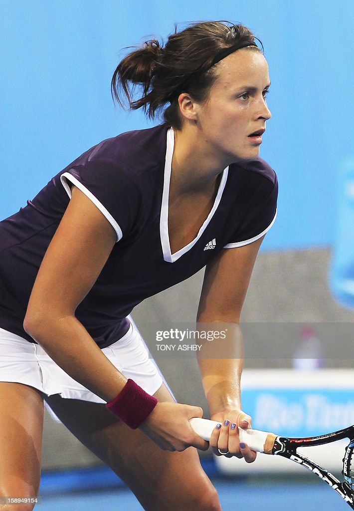 Tatjana Malek of Germany waits at the baseline waiting for Ana Ivanovic of Serbia to serve during their twelfth session women's singles match on day seven of the Hopman Cup tennis tournament in Perth on January 4, 2013. AFP PHOTO/Tony ASHBY IMAGE