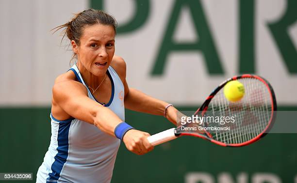 Tatjana Maria of Germany hits a backhand during the Ladies Singles second round match against Alize Cornet of France on day five of the 2016 French...