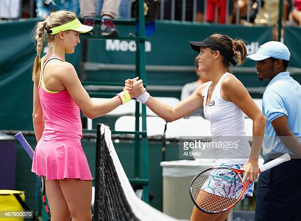 Tatjana Maria of Germany meets Eugenie Bouchard of Canada after defeating her during day 6 of the Miami Open at Crandon Park Tennis Center on March...